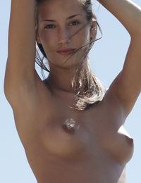 Eve,Croatian Sun,Stunning 18 year old Eve poses topless on a tropical beach.
