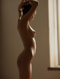 Alexis,Tiny Dancer,A perfect little ballerina admires herself in the mirror as she stretches her slender body.